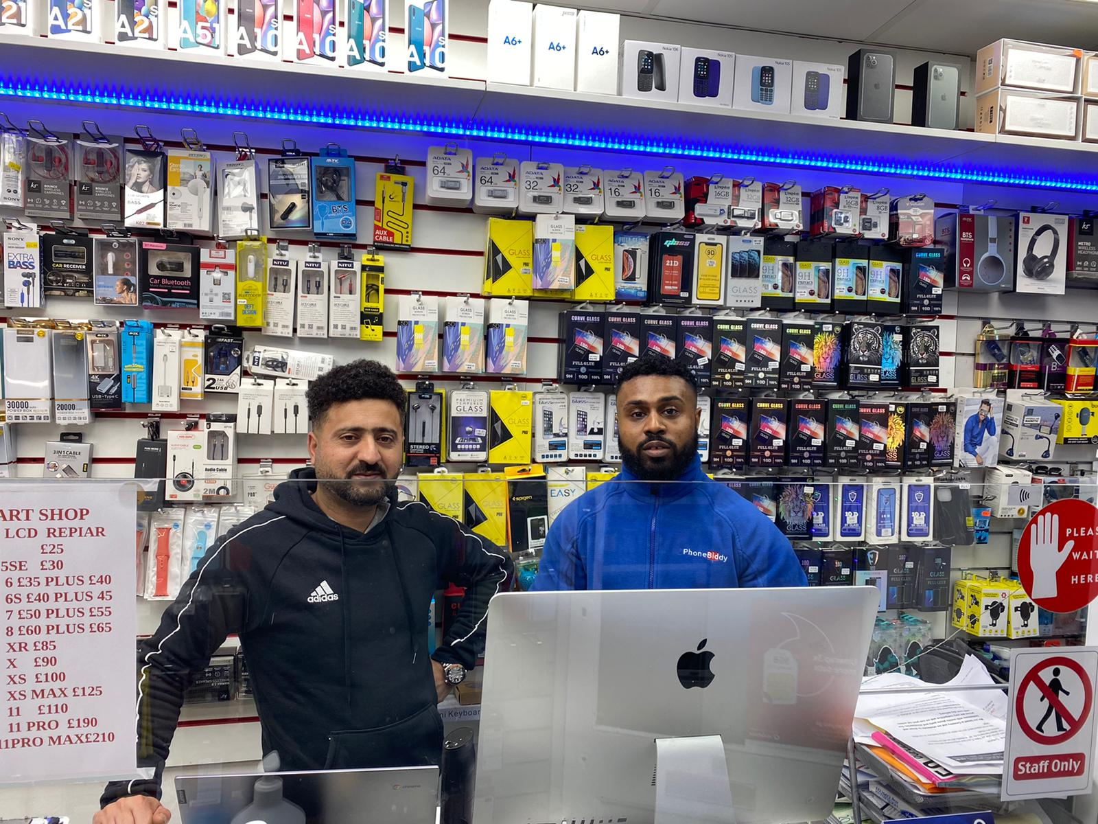 location: Bournemouth, store: smart shop, image may contain: two men in a phone repair shop, samsung A10 smartphone, usb charger leads, front glass repair kit, apple imac